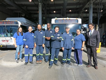 Arc team members at the MTS Imperial Avenue Division bus facility (from L to R): Job Coach Ariana Soto, Arc bus detailers Robert Sheehy, Rashaad Brooks-Provost, Derrick Pennick, Michael Zapata, Adam Rocksandich, Job Coach Theresa Kaluzny (ret.) and MTS Maintenance Analyst Jerry Stafford