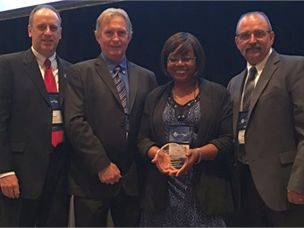 L to R: Assistant Manager Robert Hiss, Transit Maintenance Administrator Terry Ferguson, Superintendent of Operations Pat Hale, and Transit Director Butch McDuffie receive the award at the Community Transportation Association of America annual conference.