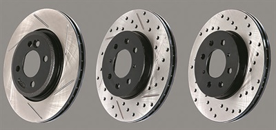 Aftermarket performance rotors are offered in a variety of designs. Examples shown here (from left to right) include slots, slots and cross-drilled holes and cross-drilled holes only. Note that non-friction surfaces are e-coated to prevent rust and to maintain a like-new appearance.