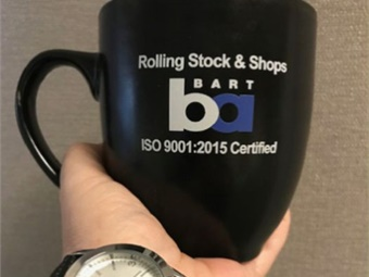 Mugs and banners help keep BART's quality policy at the top of mind.