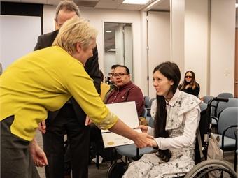 BART Board member Liz Ames presents Sophia Humphrey with a commendation.BART