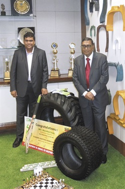 Rajiv Poddar (left), and Arvind Poddar take a moment to pose at their BKT corporate offices. Numerous quality award trophies are on display in the background.