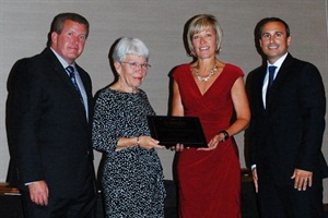 Riley Williams was honored posthumously as SBF's 2015 Contractor of the Year. Carol Williams (middle left), Riley's wife, and Chloe Williams, their daughter, accepted the award on his behalf. At left is outgoing NSTA President Tim Flood. At right is SBF General Manager James Blue.Photo courtesy NSTA