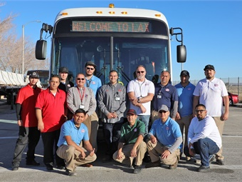 BYD team members in front of the 400th bus built in Lancaster, Calif., which will be delivered to Los Angeles World Airports.