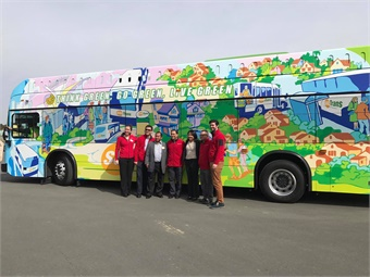 Mona Babauta, former director of SolTrans(third from right), with artist Miro del Salazar (third fromleft) and SolTransstaff members.BYD's K9 ElectricBus is the longest range 40-foot electric transit busavailable in NorthAmerica. Photo Credit: Vallejo Together