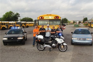 "Norman, Okla., police officers have partnered with Norman Public Schools for the ""Badges on Buses"" initiative to catch motorists who illegally pass stopped school buses."