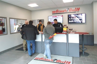Bauer Built employees serve customers in the lobby of the newly remodeled store in Durand, Wis. The project was completed in March.
