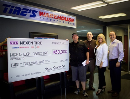 Mike Power picked up his sweepstakes winnings from Kyle Roberts, director of marketing for Nexen, alongside Tire's Warehouse Territory Sales Manager Cheryl McMurray and Regional Sales Manager Kirk Papazian.