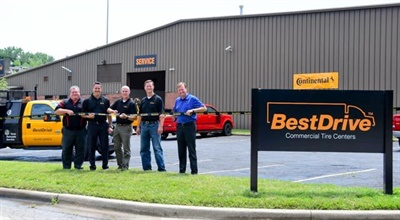 BestDrive executives attended a ribbon-cutting ceremony on June 29 for the new Kansas City location (from left): Paul Martin, Jeff Wolcott, Sonny Simpson, Steve Postel and Richard Brahler.