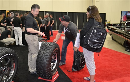 Les and Tina Foster talk to Continental's Chris Schaible about the General Grabber tire during the vendor fair. The Fosters own a Big O Tires store in Gardner, Kan.
