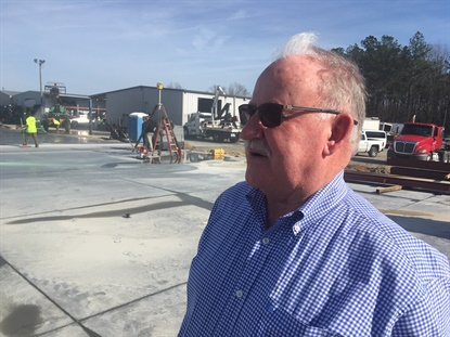 Ricky Benton of Black's Tire Service Inc. surveys the site of the future 65,000-square-foot addition to the deadlership's central distribution center in Whiteville, N.C. Contractors laid the concrete floor in January 2020.