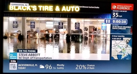 The Weather Channel reported from the Black's Tire store in the northern part of Lumberton, N.C. This screen capture shows the extent of the flooding triggered by Hurricane Florence, which made landfall about 70 miles away in Wilmington on Sept. 14.