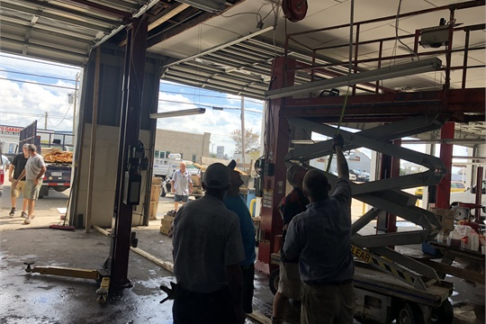 The flood waters have receded and repairs are under way at a Black's Tire store in Lumberton.