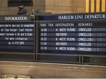Departure signs and an empty concourse at Grand Central Terminal following a shut down of Metro-North Railroad service as per Governor Cuomo's travel ban due to Winter Storm Juno on January 27, 2015. Photo: Metropolitan Transportation Authority / Patrick Cashin