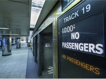 Departure signs and an empty concourse at Penn Station following a shut down of Long Island Rail Road service as per Governor Cuomo's travel ban due to Winter Storm Juno on January 27, 2015. Photo: Metropolitan Transportation Authority / Patrick Cashin