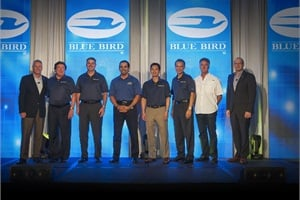 Phil Horlock (far left), president and CEO of Blue Bird Corp., commended the school bus manufacturer's award-winning dealerships for their commitment to providing school districts and contractors with a high level of service and support.
