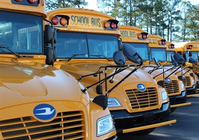 New research has found thatnitrogen oxide emissions measured from propane school buses areabout 95% less than those measured from diesel buses. Shown here are Blue Bird Vision propane school buses.