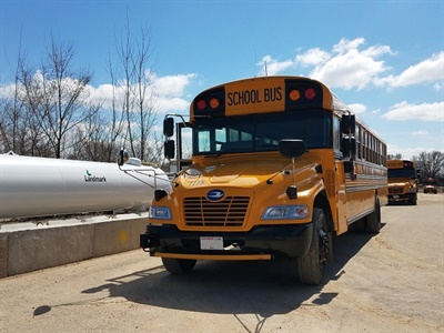 Kobussen Buses Ltd. and Oshkosh Area School District are donating the use of some of their propane school buses to transport attendees for the Experimental Aircraft Association's AirVenture event.
