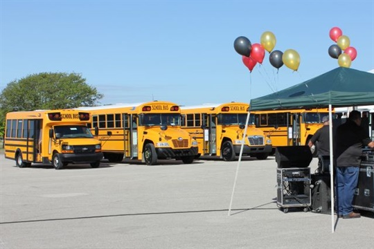 A Rush Bus Centers event showcased Blue Bird and Micro Bird school buses, with engine offerings including diesel, gasoline, and propane.
