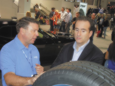 Cooper Tire & Rubber Co.'s Scott Jamieson, left, gives performance pointers on the new Zeon RS3-G1 premium all-season UHP tire to automotive industry analyst Nick Mitchell.