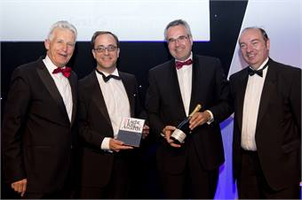 Germar Wacker and Oliver Schmidt from Bombardier Transportation collecting the Light Rail Award for Manufacturer of the Year from BBC anchorman and awards host Nicholas Owen (left) and Norman Baker MP, parliamentary under-secretary of state for transport (right)