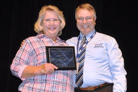 Bonnie See was recognized as Special Needs Driver of the Year in Idaho. She is seen here with Paul Arnett, Cascade Student Transportation's interim operations manager.