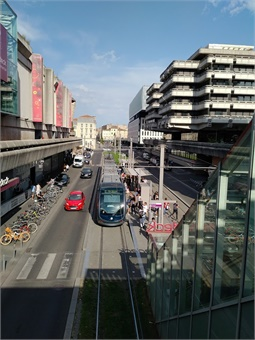 Tram stop at shopping center in Central Bordeaux.
