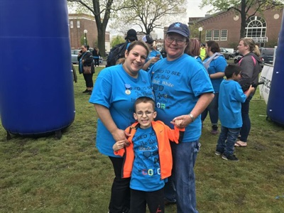 Durham staff members such as Lara Hobbs (right) are helping school bus driver Brenda Barbosa (left) raise funds to boost autism awareness. Shown with them is Barbosa's son Jaden (JB).