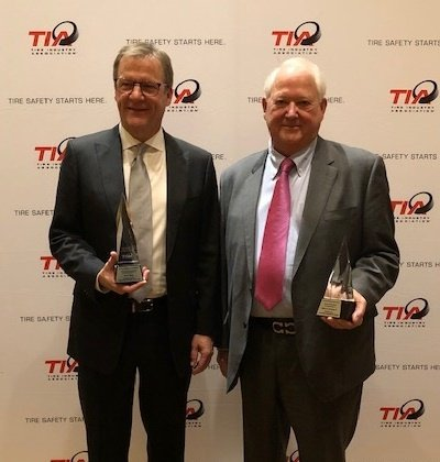 TIA named Fountain Tire CEO Brent Hesje (left) to the 2019 Hall of Fame and presented the 2019 Ed Wagner Leadership Award to Edward Burleson Sr., president and owner of Central Marketing Inc.
