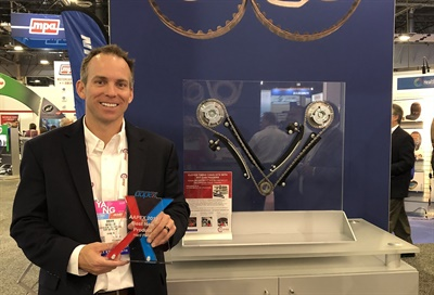 Brian Wheeler, vice president of business development and marketing for Cloyes, holds the AAPEX best new product award the company won for itsVVT Chain Kits.