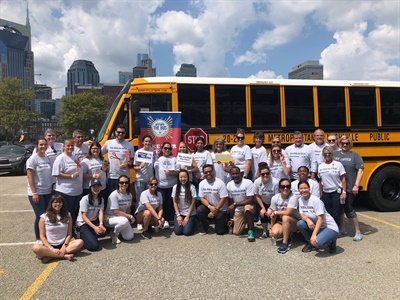 More than 200 Bridgestone employees attended the organization's Stuff the Bus event that filled backpacks with donated school supplies for local elementary school children.