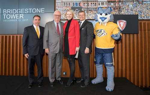 Bridgestone and Nashville leaders celebrated the grand opening of the company's headquarters and the extension of the company's naming rights for Bridgestone Arena, home of the Nashville Predators. From left are Predators executives Sean Henry, CEO and president, and Thomas Cigarran, co-owner and chairman, and Bridgestone Americas executives Chris Karbowiak, chief administrative office and executive vice president, and Godon Knapp, president and CEO.