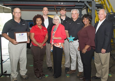 Officials from the North Carolina Department of Labor (NCDOL) congratulate employees at Bridgestone's Oxford retread plant (from left): David Martin, Kimberly Bostic, NCDOL; William Holden, commissioner; Cherie Berry, NCDOL; Jared Noah; Mark Highland, Eursula Joyner, NCDOL; and Chris Daniel.
