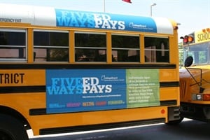 A new report found that 13 states allow advertising on the inside and/or outside of school buses. Pictured is a Houston Independent School District bus with a college ad.