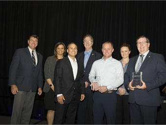 Proterra and the Rock Island County Metropolitan Mass Transit District officials flank METRO Magazine Publisher James Blue (third from left) during the awards ceremony at BusCon 2019. Mark Hollenbeck