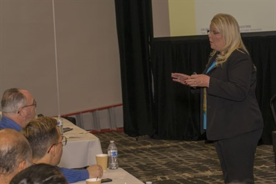 Stephanie Oliver, a transportation programs consultant at the California Department of Education (DOE), updated attendees on the status of a law requiring child-check reminder alert systems in the state. Photo by DG Photo LA, courtesy of CASTO