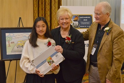 Greg and Donna Marvel of TransTraks recognized Eden Choi, a sixth grade student at Fairmont Private Schools, as CASTO's 2019 safety poster contest winner.