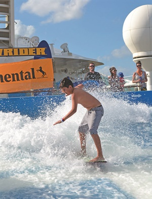 Rocco Delaval, the grandson of Bud and Claudia Luppino, attempts to master Royal Caribbean's FlowRider surf simulator. The Luppinos own Bud's Tire Pros, a three-store dealership based in Riverside, Calif.