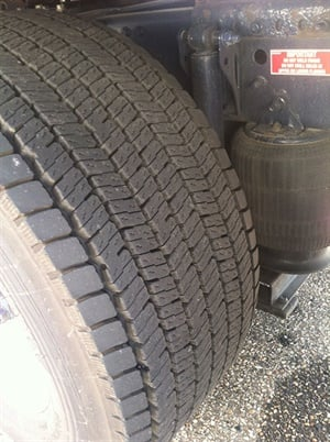 These tires are on one of Ploger Transportation's 6x2 tractors. Both have about 70,000 miles on them, the company reports. The tire on the left is a drive tire, the tire on the right is on the lift axle.