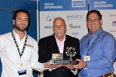 IVC Chairman Ira Davis (center) presented the Best Performance Product Award to Centric Parts President/CEO Dan Lelchuk (right) and StopTech engineer Tyler Hauptman.