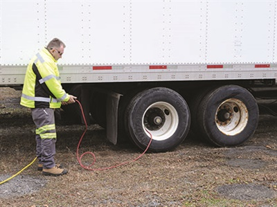 High visibility clothing is a necessity whenever servicing tires on the side of our nation's highways.