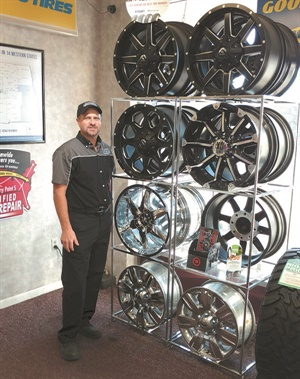 Damon Nielson stocks a small supply of custom wheels at his Tire Factory Point S shop.