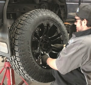Technician Devin Goodwin services a custom wheel at Tire Factory Point S, which has sold custom wheels since 1971.