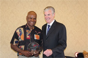 Henry Bell, a school bus driver for Roseville (Calif.) Joint Union High School District, receives his award from Tom Torlakson, state superintendent of public instruction.