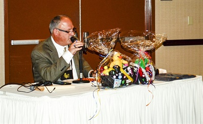Dano Rybar,transportation consultant at the California Department of Education, calls out bingo numbers during a session that combined the game with quizzes on special-needs transportation information.