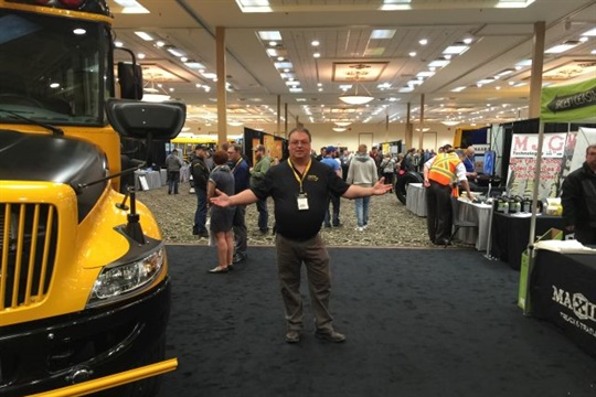 "More than one Canadian Pupil Transportation Conference attendee said that the Manitoba hosts reflected their license plates' slogan: ""Friendly Manitoba."" Seen here is Todd Nichols of Border Land School Division, who served as trade show chairman."