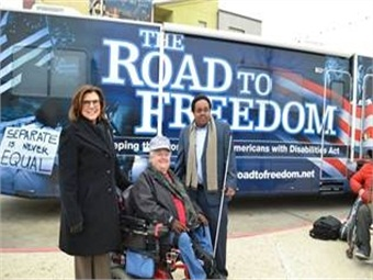 Photo of the ADA Legacy Tour bus stop at Capital Metro's Crestview Station March 2, 2015. (Pictured left to right: Capital Metro President/CEO Linda Watson, ADAPT of Texas Representative Nancy Crowther and Capital Metro Accessibility Specialist Martin Kareithi).