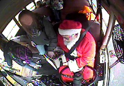 Bailey handed out holiday treats as he delivered kids to school, as seen in surveillance footage from the bus.