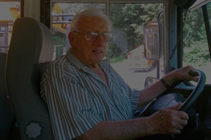 At 85, Charlie Nichols continues to drive a school bus every day.