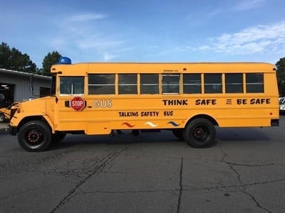 The district is also relaunching Gus the Bus (shown here), a talking school bus designed to teach students about safety — which was on display at the briefing. Photo courtesyCharlotte-Mecklenburg Schools
